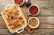 Potato casserole with parmesan cheese, cream and delicious fried bacon.top view - 196672290