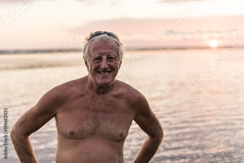 A 60s Man at the beach having good time