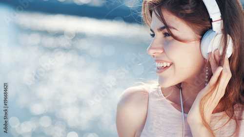 Smiling woman listen to music