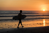 Surfer watching the waves at sunset in Costa Rica