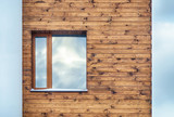 Window on a wall lined with wood