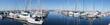 Reflections of sailboats in marina