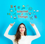 Internet of Things with young woman reaching and looking upwards