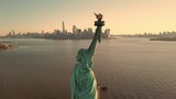 Statue of Liberty at beautiful sunset - aerial circling toward Manhattan skyline in New York City NYC in 4K and 1080 HD - 196711837