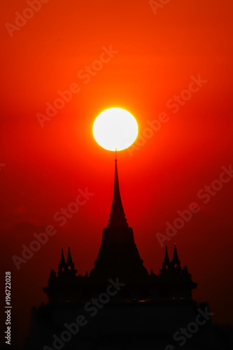 Fotobehang Rood Sunset silhouette temple hight sky in bangkok thailand