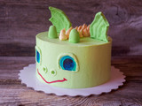 original homemade cake in the form of a dinosaur head