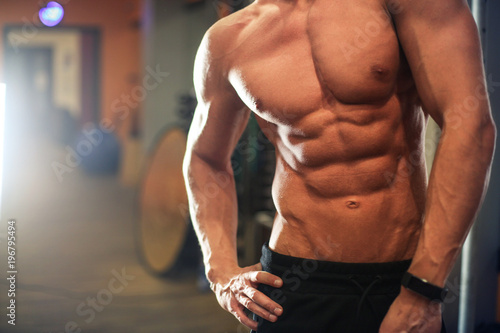 Wall mural Fit and muscular body