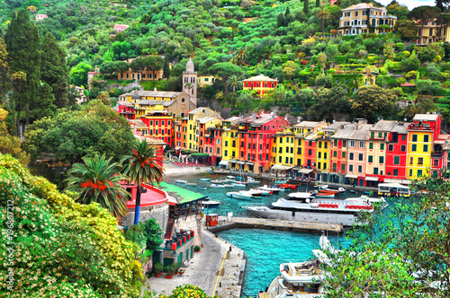 Foto Murales The beautiful Portofino panorama with colorfull houses, luxury boats and yacht in little bay harbor. A vacation resort with celebrity visitors. Liguria, Italy,Europe