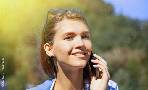 Portrait of pretty happy lovely young woman speaking on mobile phone. Love and positive emotion concept.