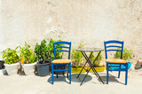 Two chairs in a patio of traditional greek house - 196824214