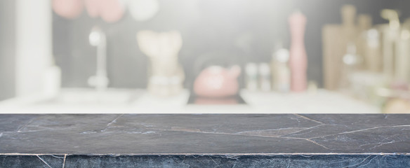 Empty Black stone table top and blurred kitchen interior banner background - can used for display or montage your products. © bunditinay