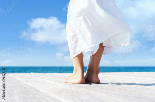 Beautiful female legs. Summer vacation concept.
