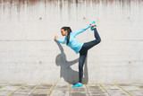 Young, fit and sporty girl stretching. Fitness, sport, urban jogging and healthy lifestyle concept.