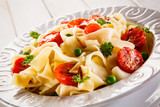 Pasta with vegetables on wooden table - 196838488