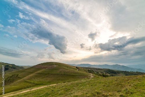 Beautiful mountain landscape with trees and a cloudy morning sky, Dumesti, Salciua, Apuseni, Romania