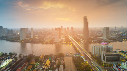Top view River cured in Bangkok city downtown with sunset sky background