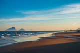 Beautiful evening sunset on the beach in Prachuab Khiri Khan, southen part of Thailandwith colorful sky, sand beach sea wave and mountain in the background. - 196847209