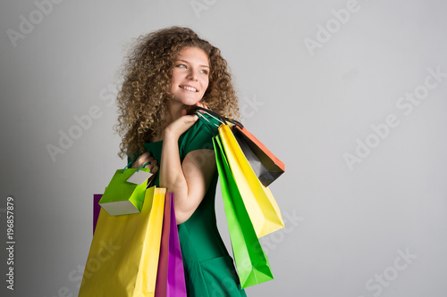woman with shopping bags in hands