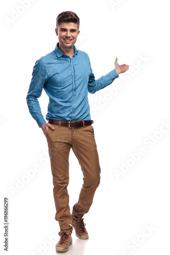 smiling young casual man presenting