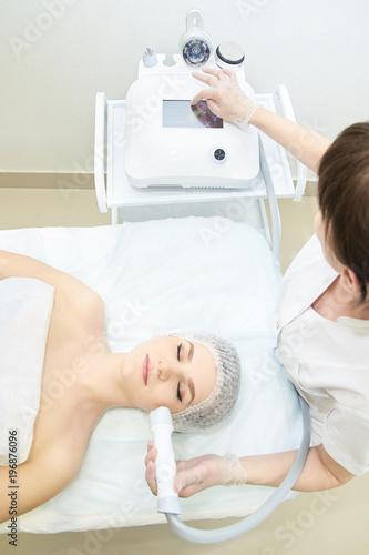 Foto Murales Endermolift cosmetology. Vacuum face equipment. Hand set device