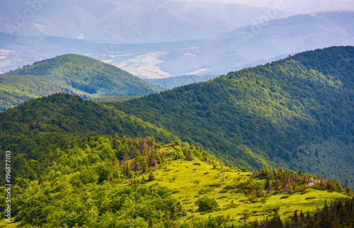 Blue sky beautiful rolling hills of Carpathian mountains. lovely summer landscape, bird eye view