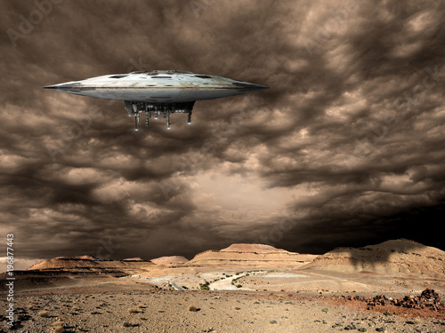 Fotobehang UFO a large saucer shaped mothership hovers over a barren world. - Elements of this image furnished by NASA.
