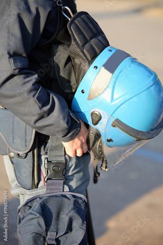 blue helmet of a policeman riot cop
