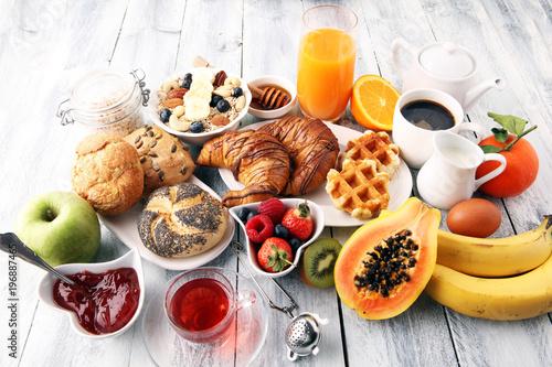 Fotobehang Sap Breakfast served with coffee, orange juice, croissants and fruits. Balanced diet.