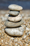 pyramid of colorful pebbles . Rock Zen in the background of the sea. Concept of harmony and balance. - 196888645