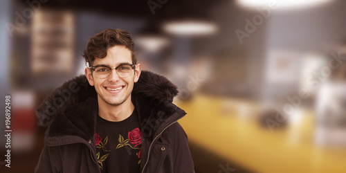 fashionable young man smiling with space for text