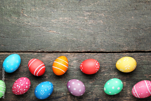 Colorful easter eggs on grey wooden table