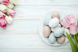 Tulips with easter eggs in plate on wooden table - 196906017
