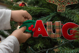 Hanging Balls and Decorations on Christmas Tree - 196911219