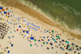 Top view of beach colorful umbrellas and people relaxing