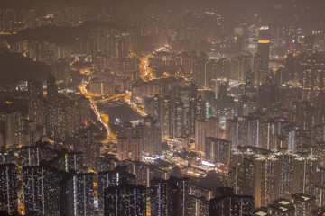 Residential Buildings in Hong Kong at Night. Panoramic Aerial View.