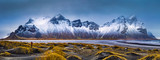 Vestrahorn mountain range and Stokksnes beach panorama, near Hofn, Iceland. An unidentifiable photographer captures the scenery. - 196923462
