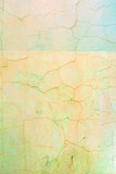 Wall with cracked pale yellow and green paint. Bright background with vignette. Texture of old cover with cracks. - 196929409