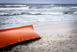Orange boat on sandy beach - 196931836
