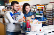 Couple in paint supplies store