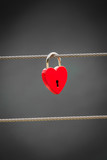 Red love lock padlock on bridge outdoor - 196934451