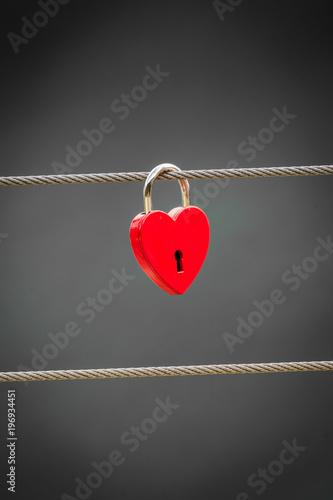 Red love lock padlock on bridge outdoor - 196934451