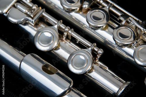 Close up of the silver plated musical instrument flute - 196941286