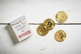 Bitcoins with tear-off calendar and message