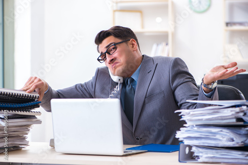 Desperate sad employee  tired at his desk in call center - 196956693