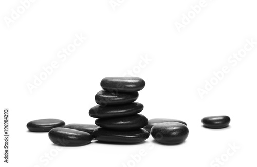 Foto op Canvas Zen Pile black rocks isolated on white background