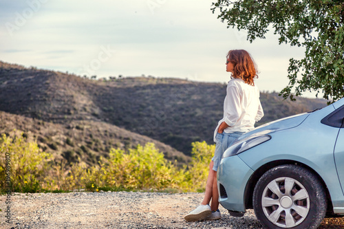Beautiful stylish young girl travels by car, summer travel, freedom, transport for rent, new impressions and adventure, freedom and youth