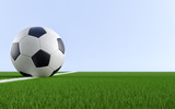 Soccer ball on the white line of a soccer field. Copy space on the right side - 3D Rendering - 197009847