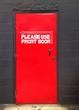 A red door with sing Please Use Front Door - 197015294