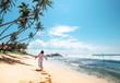 Quadro Woman in long dress walks on tropical island beach