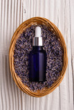 Lavender essential oil on a wooden background